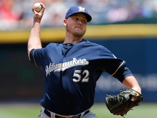 Milwaukee Brewers starting pitcher Jimmy Nelson delivers
