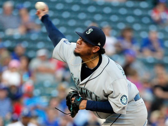 Seattle Mariners' Felix Hernandez throws to the Texas