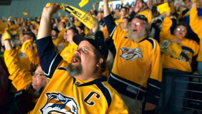 From Section 303, better known as Cellblock 303, Nashville Predators fan Jeff Miller cheers May 7 at Bridgestone Arena.