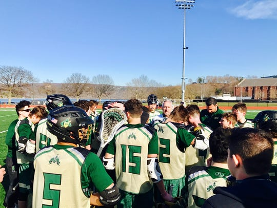 Dan DaPonte (pictured back right) with the St. Joseph lacrosse team after a game last season at Army's West Point campus.