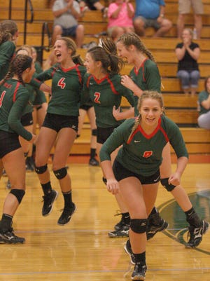 The Oak Harbor Rockets celebrate their victory over the Clyde Fliers.