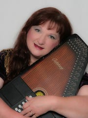 With a three octave range, and accompanying herself on autoharp, Lee sings folk-style music.