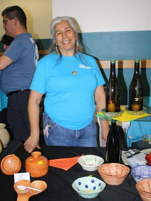 The Empty Bowls event features handcrafted bowls made by potters like Stella Ruiz and other community members.