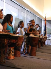 Attendees practice drumming at a Juneteenth celebration at Tempe History Museum on June 18, 2016.
