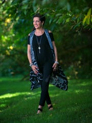 Angela Jo Manieri wears philosophy black knit stretch pants; Jones of New York top from Marshalls; and a black, gray and whitevest from Simply Grace Boutique.