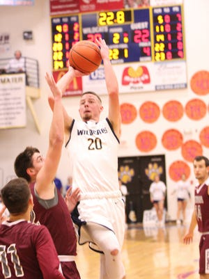 Woodmore's Mitchell Miller reached 1,000 career points Friday against Genoa.