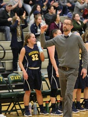 Woodmore coach Kyle Clair celebrates Katie Brugger's buzzer-beating shot in the third quarter.