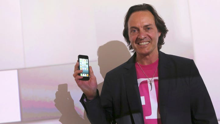 T-Mobile CEO John Legere speaks during a news conference