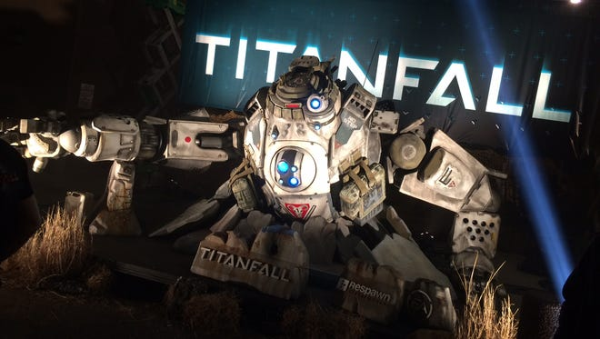 A large model of a titan from the video game 'Titanfall' awaited attendees outside the game's launch party in Austin, Tx.