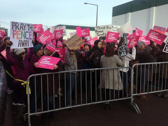 Supporters of Planned Parenthood hold counter protest as abortion opponents demonstrate outside Planned Parenthood  in St. Paul, Minn., on Saturday, Feb. 11, 2017.  Rallies aimed at urging Congress and President Donald Trump to end federal funding for Planned Parenthood are scheduled across the country.