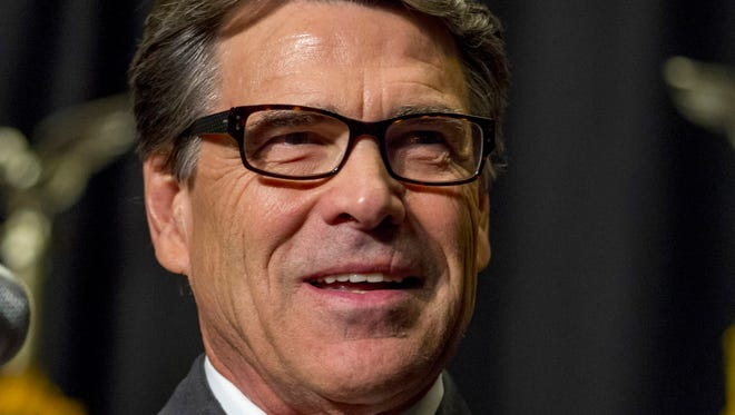In this Nov. 7, 2013, file photo, Texas Gov. Rick Perry speaks in Des Moines, Iowa. Getting ready to run for president means working through a hefty checklist of activities long before most people are paying attention to the contest ahead.