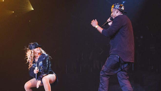Jay Z joins his wife Beyonce onstage during her Mrs. Carter Show world tour on Aug. 5, 2013, at the Barclays Center in Brooklyn.