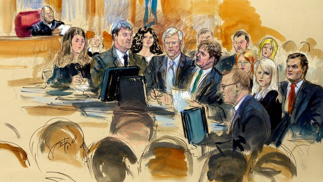 In this courtroom sketch at the federal corruption trial of former Virginia Gov. Robert F. McDonnell, center, and his wife, former first lady Maureen McDonnell, second from right, Judge James R. Spencer, left, presides during jury selection July 28, 2014, in Richmond, Va.