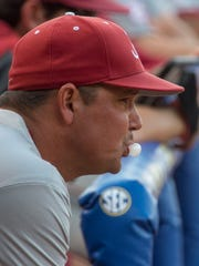 Alabama coach Mitch Gaspard blows a bubble as his team bats against Mississippi State in the Southeastern Conference baseball tournament, Wednesday, May 25, 2016, at the Hoover Met in Hoover, Ala. (Vasha Hunt/AL.com via AP)