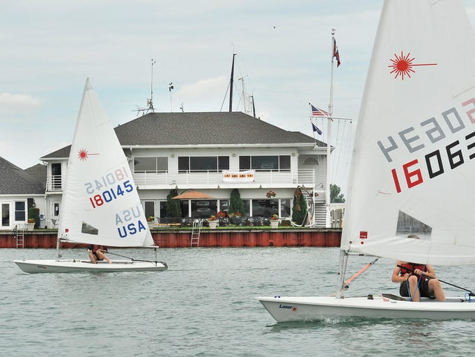 Eva Rossell, 14, and Anthony Lane, 15, sail past the