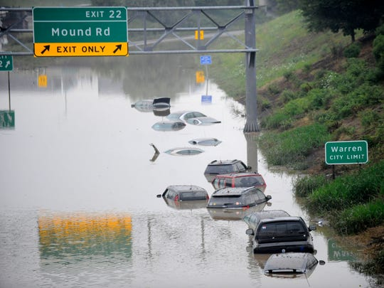 """Freeway or Lake?,"" by David Coates, shows the flooding on I-696 near Mound Road in Warren during last August's storms."