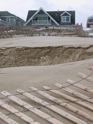 This Jan. 29, 2016 photo shows an oceanfront home in Point Pleasant Beach, N.J. owned by Todd Christie, the brother of Republican presidential candidate, New Jersey Gov. Chris Christie. The governor's environmental protection department wants to seize a strip of beach behind his brother's house as part of a protective dune system.