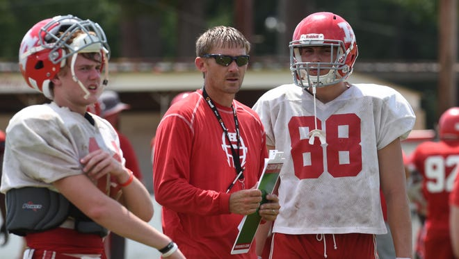 Haughton head coach Jason Brotherton has a word with Harrison Voight between thunderstorms this summer.