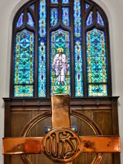 The sanctuary of First Presbyterian Church, the setting for the Crusade Choir Christmas performance, is known for its stained glass.