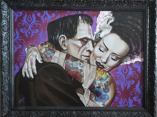 Looks like the cocktails worked for Frankenstein's monster and his fair bride in this painting by Mike Bell of Northfield.
