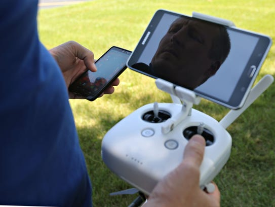 Jason Preston demonstrates flying a drone outside High Street Baptist Church in 2016. Any tablet or smartphone that will run the software can be used to see the view from the drone's camera.