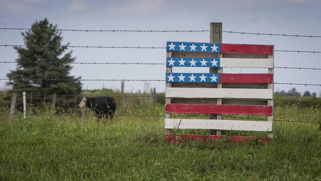 A decorated wooden palette along a fence row on a farm on Sept. 8, 2016, outside Creston, Iowa.