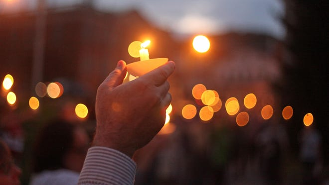 The Newton Green will be the site of a vigil on Friday, to be held in solidarity against racial injustice following the death of George Floyd at the hands of a white police officer in Minneapolis. In this Herald file photo, a participant holds a candle during a vigil held on the Newton Green in 2018 in response to attacks of vandalism and anti-Semitism that occurred in Hampton on Oct. 4, 2018.