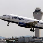 A JetBlue Airways plane takes off April 23, 2013, at Seattle-Tacoma International Airport.