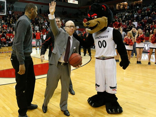 Cincinnati Bearcats head coach Mick Cronin waves to the crowd after earning his 200th win as coach following 97-75 win against the Tulane Green Wave, Sunday, Jan. 24, 2016, at Fifth Third Arena in Cincinnati. The Cincinnati Bearcats defeated the Tulane Green Wave 97-75.