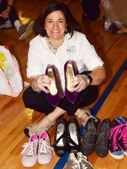 Jo Ann James, campaign co-chair, organizes shoes into