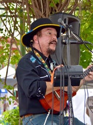 Randy Granger performs at the Franciscan Art Festival.