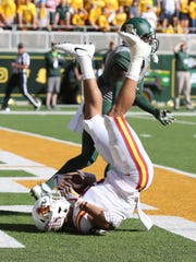 Iowa State wide receiver Allen Lazard (5) lands in the end zone while scoring over Baylor safety Taion Sells (2) in the first half of a NCAA college football game, Saturday, Nov. 18, 2017, in Waco, Texas.