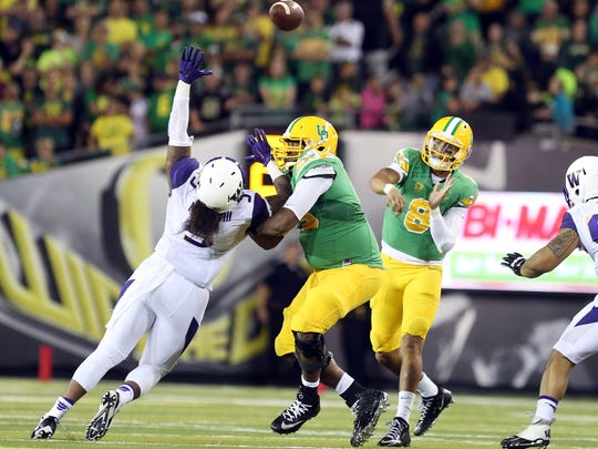 Oregon quarterback Marcus Mariota leads the nation in passing efficiency and is the Heisman Trophy frontrunner.