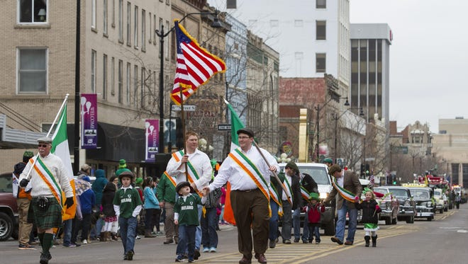 The Great Falls' division of the Ancient Order of Hibernians, a civic organization honoring Irish heritage and organizers of the annual parade, marches down Central Avenue as part of the 2015 St. Patrick's Day Parade.