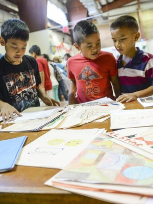 Students shared their writing skills and display their completed works during the Young Authors and Illustrators Fair at the Saint Francis School in Yona on Friday, Nov. 13. The event was held with an emphasis on literacy development amongst the students.
