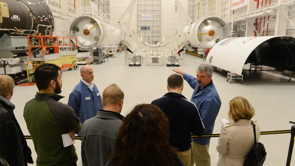 Mike Pinkston, right, general manager of the Antares