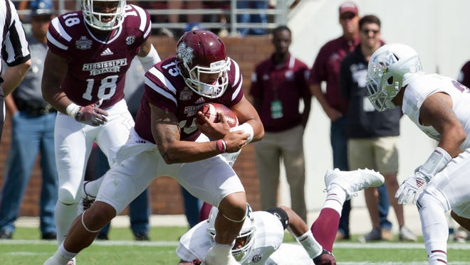Mississippi State quarterback Dak Prescott (15) rushes against Texas A&M on Saturday. Prescott threw for 259 yards and two touchdowns in the Bulldogs' 48-31 win.