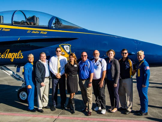 Blue Angel No. 7 pilot Lt. Andre Web with air show board members Robert Paugh (president), David Walker, Catherine Caddell, Rob Lucas (vice president), Michael Moon (air show director), Adie Ward and Joel Scher and Blue Angel No. 8 pilot Lt. Dave Steppe.