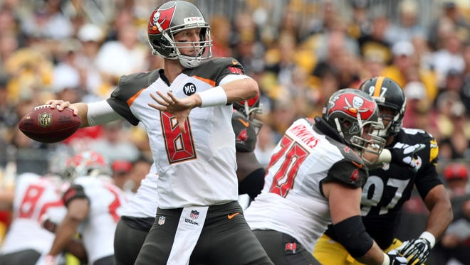 Tampa Bay Buccaneers quarterback Mike Glennon (8) throws a pass against the Pittsburgh Steelers during the first quarter at Heinz Field.