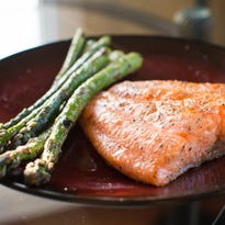 Place seasoned salmon fillets on the foil skin side down and sear 4-5 minutes.