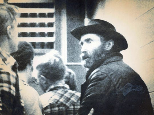 "This 1984 image shows ""mountain man"" Don Nichols, right, being taken into custody near Bozeman."