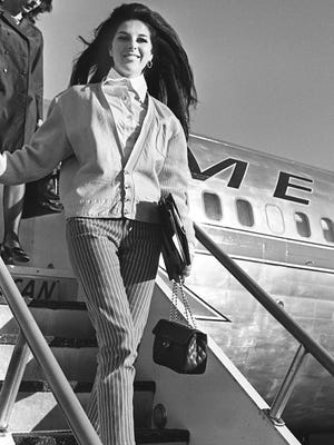 "Singer Bobbie Gentry arrives at Nashville Municipal Airport on Oct. 18, 1967, for the Grand Ole Opry's 42nd anniversary celebration and the DJ convention. Gentry wrote and recorded the hit ""Ode to Billie Joe."""