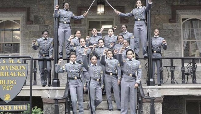A photo tweeted by recent West Point graduates may violate military rules against political speech and is being investigated.