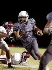 Rancho Mirage's Marques Prior runs the ball against Bell Gardens during the first half of the game in Rancho Mirage on Friday, September 29, 2017.