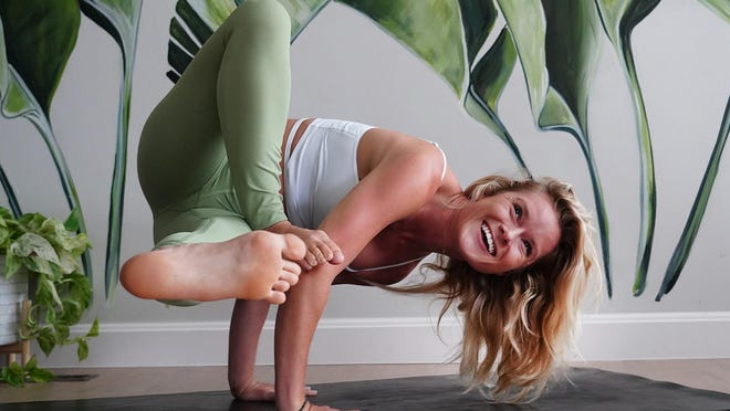 Yoga instructor Emma Brunet in her new studio at The Yoga Parlor in downtown Hampton, offering classes for all levels of yoga.