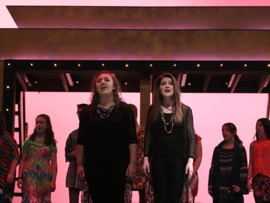 Kristin Kaufman and McKenna Stoffer sings during a