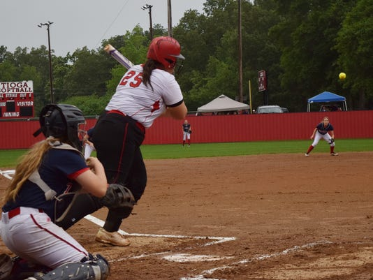 Tioga's Meghan Cumming (25, left) bats against Teurlings Catholic in a playoff game held Monday. Cumming brought two runs in and got on first.