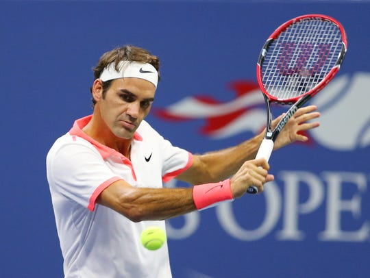 Roger Federer returns a shot to Richard Gasquet at