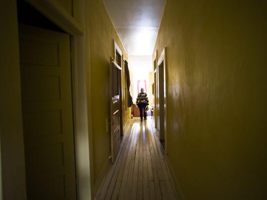 Owner Danielle Martinez walks down a hall where the