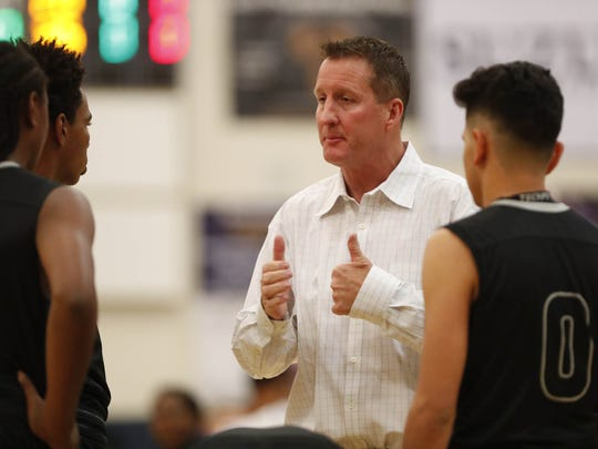Cesar Chavez head coach Gary Lee talks to his player against Desert Vista during their 6A boys basketball state tournament game in Phoenix, Ariz. February 13, 2018.